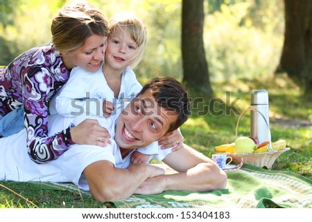 a Young family having a picnic in nature
