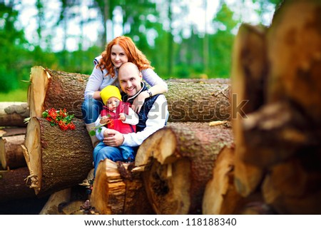a young family in the woods - stock photo