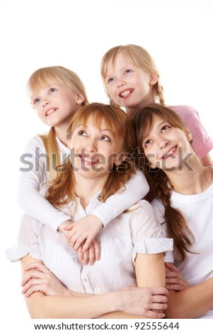 A young family of four over white background