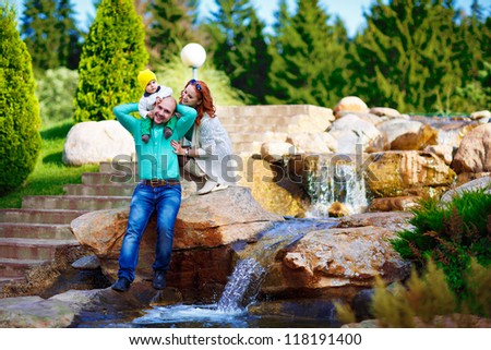 a young family on a walk - stock photo