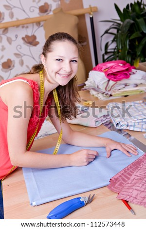 a young female couturier in the workroom