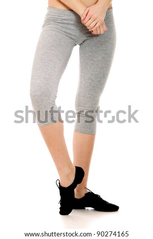 A young female dancer training - focus on legs. Isolated on white background