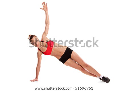 A young female exercising isolated on white background - stock photo