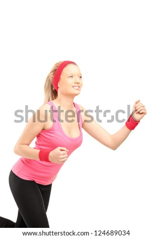 A young female runner running isolated on white background
