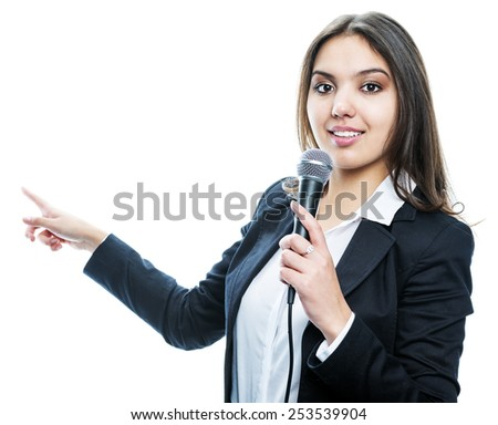 a young  female with a microphone showing to blank space behind her