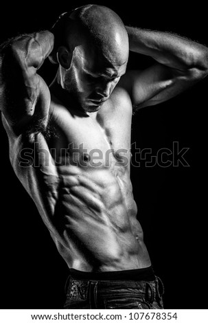 a young fit athlete posing his ripped body - stock photo