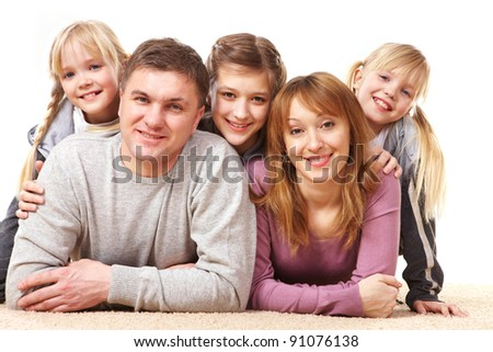 A young friendly family looking at camera on white background