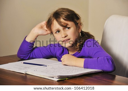 a young girl a troubled doing her homework