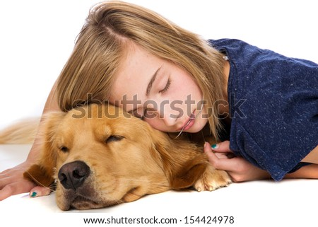 A young girl and her dog asleep during a nap - stock photo