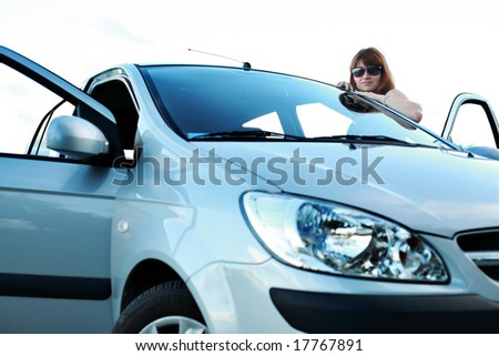 a young girl at the car - stock photo