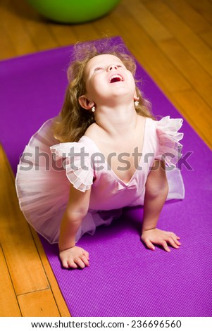 A young girl ballet dancer in a pink lace tutu - stock photo