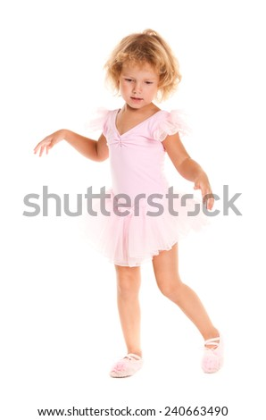 A young girl ballet dancer in a pink lace tutu Isolated on white background - stock photo