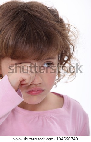 A young girl crying