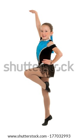 A Young Girl Dancing Jazz Mid Routine Step in Recital Costume