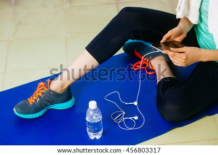 A young girl doing morning exercise. Fitness and yoga