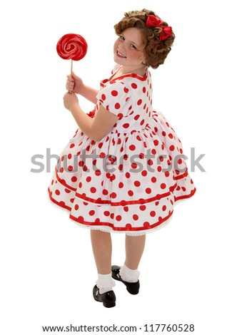 A young girl dressed up to look like Shirley Temple for halloween - stock photo