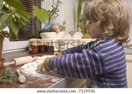 a young girl having fun in the kitchen :) - stock photo