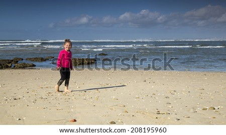 A young girl having fun on the beach