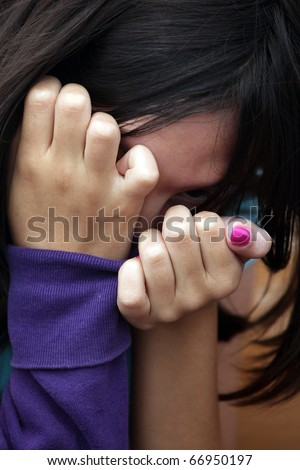 a young girl hiding - stock photo