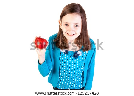 a young girl holding a delicious red apple