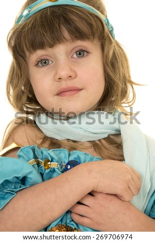 a young girl in her costume with a calm expression on her face. - stock photo