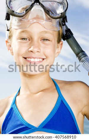 A young girl in snorkeling gear