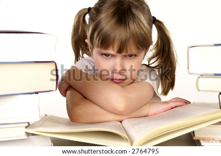 A young girl not happy about studying - stock photo
