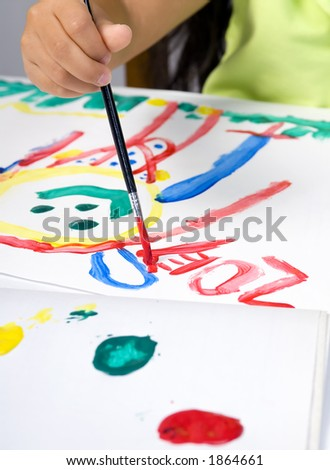 A young girl painting a self portrait...signing it. - stock photo