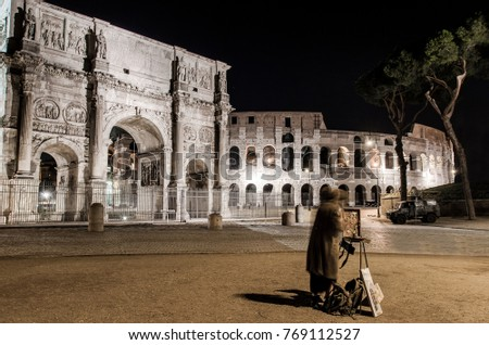 A young Girl Paints the Arch of Constantine and the Colosseum at night