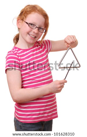A young girl plays a triangle - stock photo