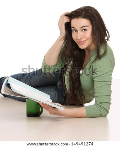 A young girl reading a book, isolated on white background - stock photo
