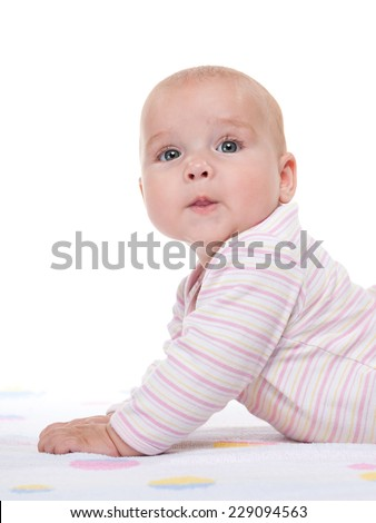 A young girl shows her fingers to the side on the white background