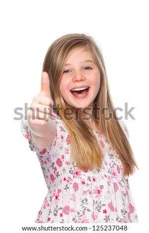 a young girl smiling and giving thumbs up - stock photo