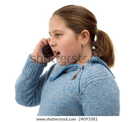 A young girl talking on a cell phone, isolated against a white background - stock photo