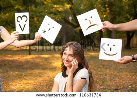 A young girl talks with someone by cell phone - stock photo