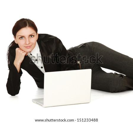 A young girl with a laptop lying on the floor
