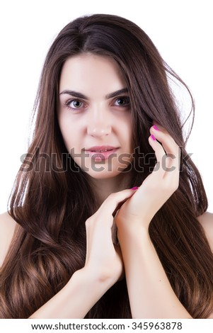 A young girl with blond hair holds her hands near the face. Isolated on white background