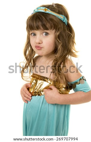 A young girl with her lips puckered in her costume. - stock photo