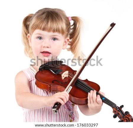 A young girl with pigtails is playing the violin.
