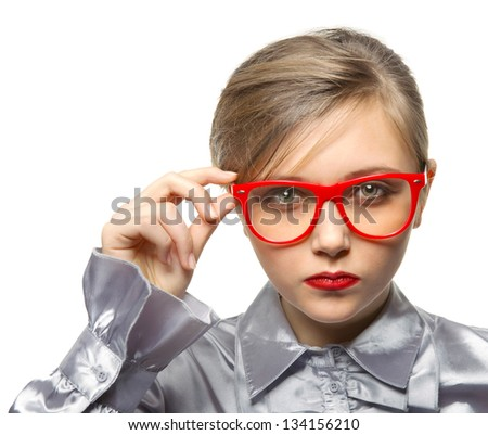 A young girl with the glasses looks strictly - stock photo