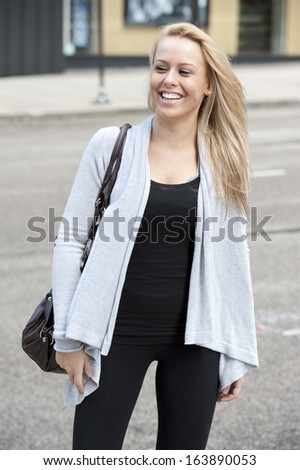 A young gorgeous female blond teen posing on a cloudy day in Chicago.