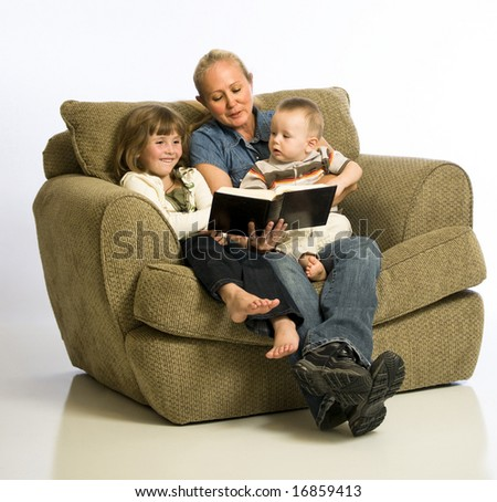 A young grandmother reads to her grandchildren.