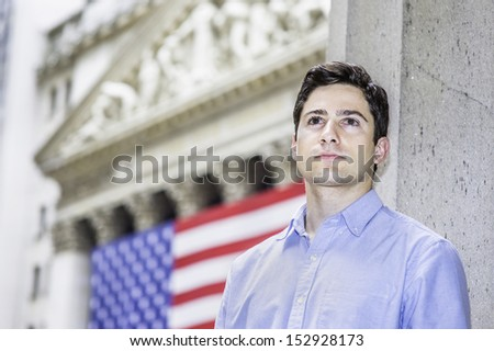 A young guy is sincerely looking forward. There is American flag in the background. / Portrait of Young Guy