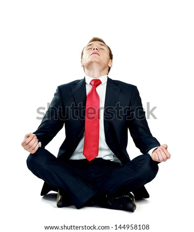 A young guy sitting on the floor, isolated on white background - stock photo