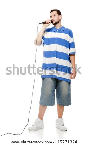 A young guy with a microphone, isolated on white background. - stock photo
