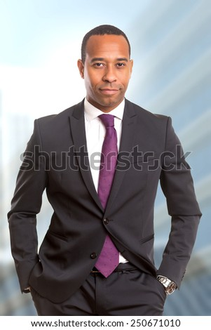 A Young handsome african business man posing - stock photo
