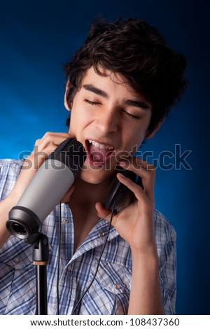 A young handsome boy singing - stock photo