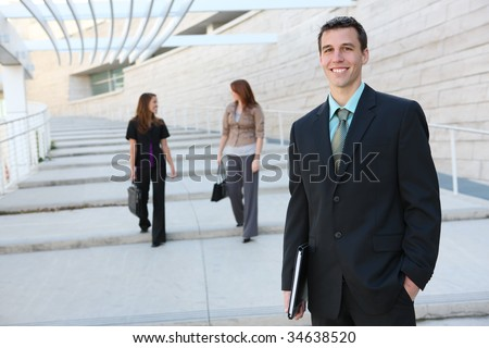 A young handsome business man at office building
