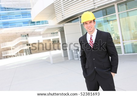 A young handsome man architect on building construction site