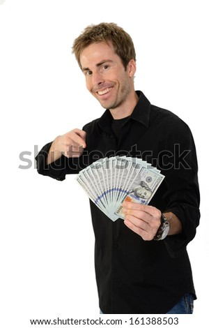 A young handsome man holding a lot of new hundred dollar bills isolated on white background.  This newly redesigned US currency was released for circulation in October of 2013.